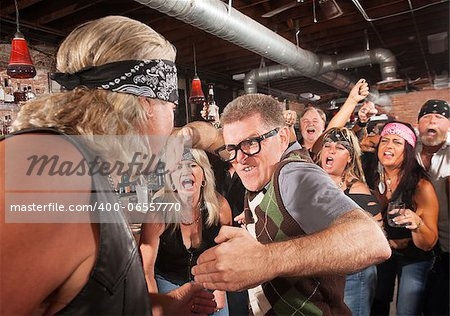 Nerd readies a karate chop in fight with gang member Stock Photo - Budget Royalty-Free, Image code: 400-06557770