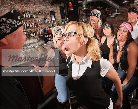 Aggressive female nerd sticking her tongue out at gang member Stock Photo - Budget Royalty-Free, Image code: 400-06557771