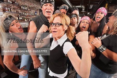 Cute female nerd flexing muscles with gang of bikers Stock Photo - Budget Royalty-Free, Image code: 400-06557772