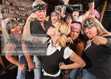 Biker gang cheering on skinny female nerd flexing muscles Stock Photo - Budget Royalty-Free, Image code: 400-06557773