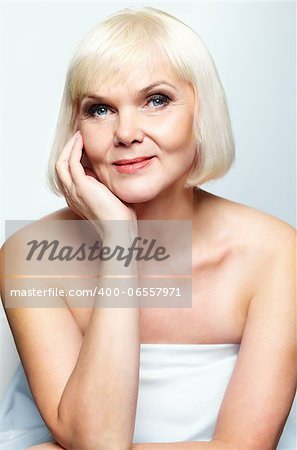 Mature lady looking at camera with smile Stock Photo - Budget Royalty-Free, Image code: 400-06557971
