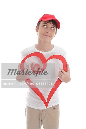 Daydreaming teenage boy holding a red valentine love heart.   Space for copy or message. Stock Photo - Budget Royalty-Free, Image code: 400-06558206