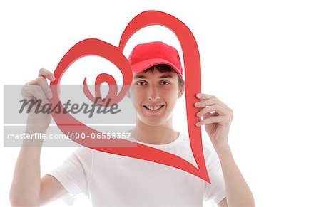 A teenager looking through a red love heart and smiling Stock Photo - Budget Royalty-Free, Image code: 400-06558357