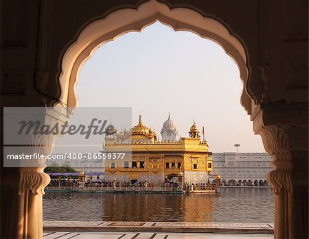 Amritsar Golden Temple - India. Framed with windows from west side. focus on temple Stock Photo - Budget Royalty-Free, Image code: 400-06558377