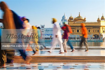 Group of Sikh pilgrims walking by the holy pool, Golden Temple, Amritsar, Pun jab state, India, Asia Stock Photo - Budget Royalty-Free, Image code: 400-06558379