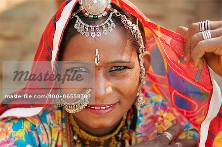 Beautiful Traditional Indian woman in sari costume covered her head with veil, India Stock Photo - Budget Royalty-Free, Image code: 400-06558382