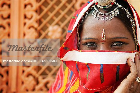 Traditional Indian woman in sari costume covered her face with veil, India Stock Photo - Budget Royalty-Free, Image code: 400-06558383
