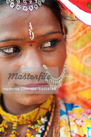 Traditional Indian woman in sari costume looking away, India Stock Photo - Budget Royalty-Free, Image code: 400-06558384