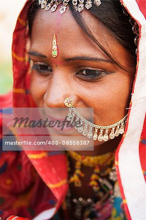 Young Traditional Indian woman in sari costume covered her head with veil, India Stock Photo - Budget Royalty-Free, Image code: 400-06558387