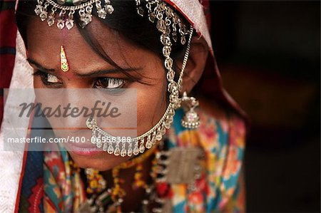 Portrait of Traditional Indian woman in sari costume covered her face with veil, India Stock Photo - Budget Royalty-Free, Image code: 400-06558388