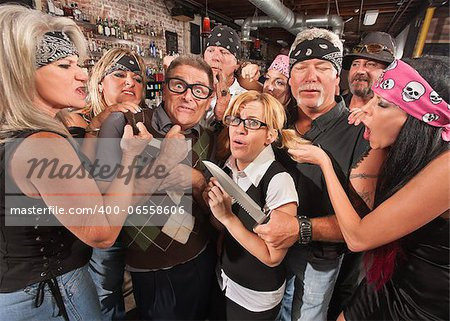 Scared nerd couple in tavern with rowdy gang Stock Photo - Budget Royalty-Free, Image code: 400-06558606