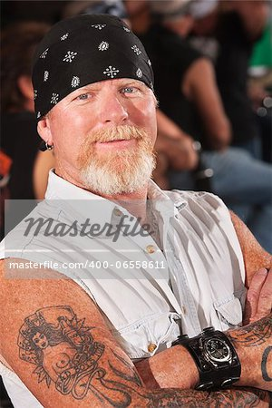 Smiling middle aged motorcycle gang man with folded arms Stock Photo - Budget Royalty-Free, Image code: 400-06558611