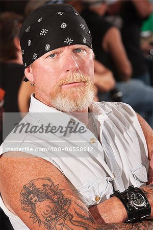 Serious male gang member with folded arms Stock Photo - Budget Royalty-Free, Image code: 400-06558612