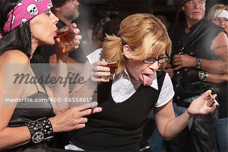 Nerd gagging on alcohol while drinking in bar Stock Photo - Budget Royalty-Free, Image code: 400-06558617