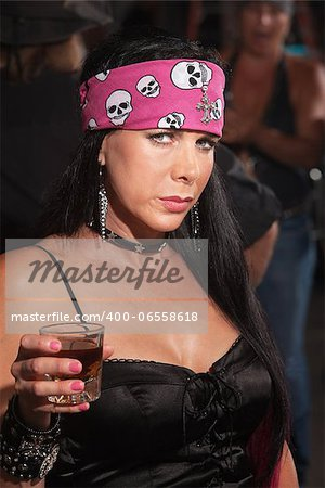 Serious beautiful woman in motorcycle gang outfit in bar Stock Photo - Budget Royalty-Free, Image code: 400-06558618