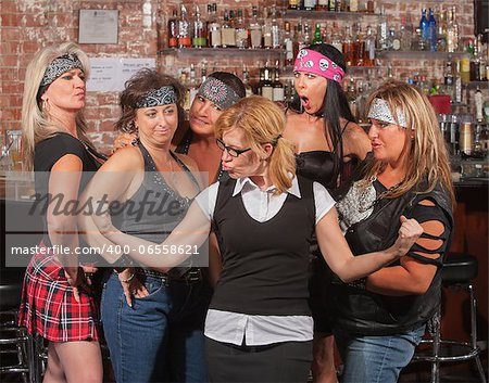 Skinny female nerd flexing muscles in front of motorcycle gang Stock Photo - Budget Royalty-Free, Image code: 400-06558621