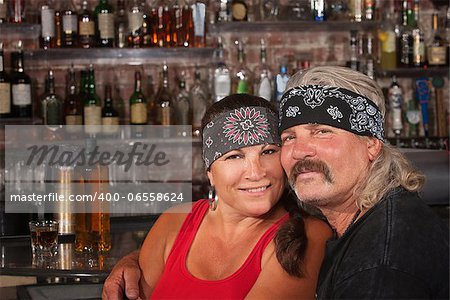 Cute motorcycle gang husband and wife together in bar Stock Photo - Budget Royalty-Free, Image code: 400-06558624