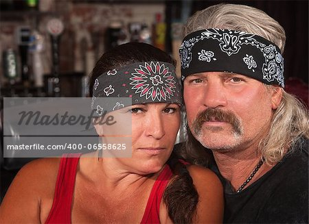 Serious middle aged couple in bandannas at a bar Stock Photo - Budget Royalty-Free, Image code: 400-06558625