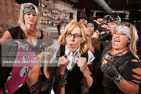 Motorcycle gang members force a fight with nerd in bar Stock Photo - Budget Royalty-Free, Image code: 400-06561339