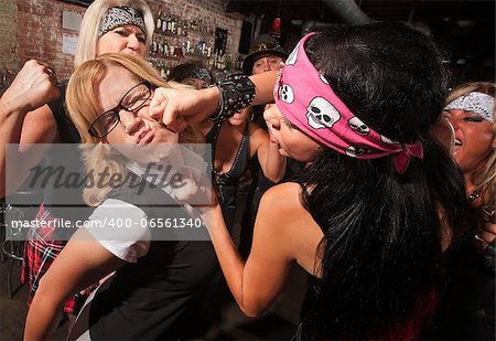 Female nerd with eyeglasses punched in fight with gang Stock Photo - Budget Royalty-Free, Image code: 400-06561340