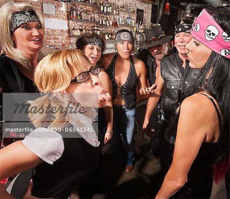 Brave nerd with glasses sticks tongue and tough woman Stock Photo - Budget Royalty-Free, Image code: 400-06561341