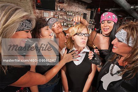 Female motorcycle gang touching a frightened nerd Stock Photo - Budget Royalty-Free, Image code: 400-06561342