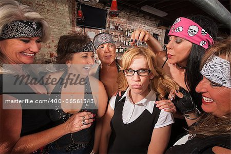 Cruel gang of mature women teasing a nerd in a bar Stock Photo - Budget Royalty-Free, Image code: 400-06561343