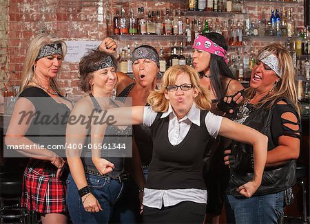 Female motorcycle gang laughing at nerd in bar Stock Photo - Budget Royalty-Free, Image code: 400-06561344