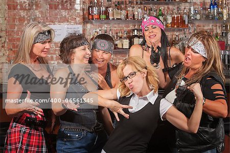 Nerd flexes muscles for tough female gang in bar Stock Photo - Budget Royalty-Free, Image code: 400-06561345