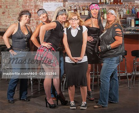 Nervous nerd lady in between gang of tough women in bar Stock Photo - Budget Royalty-Free, Image code: 400-06561346