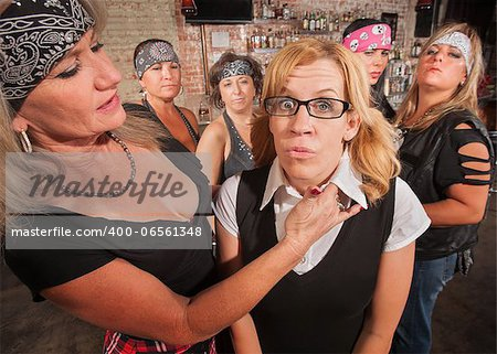 Tough biker gang woman with hand near female nerd's neck Stock Photo - Budget Royalty-Free, Image code: 400-06561348