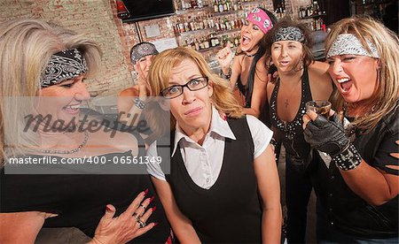 Frightened blond nerd laughed at by gang of women Stock Photo - Budget Royalty-Free, Image code: 400-06561349