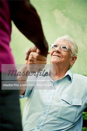 retired elderly people and free time, happy senior african american and caucasian male friends greeting and sitting on bench in park Stock Photo - Budget Royalty-Free, Image code: 400-06570245