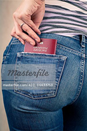 Shot of young womans behind in worn out jeans and passport in a pocket Stock Photo - Budget Royalty-Free, Image code: 400-06633713
