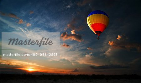 Colorful hot air balloon is flying at sunrise Stock Photo - Budget Royalty-Free, Image code: 400-06642893