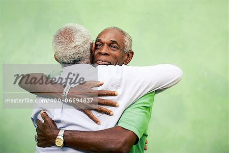 Active retired old men and leisure, two senior black brothers hugging outdoors Stock Photo - Budget Royalty-Free, Image code: 400-06694837