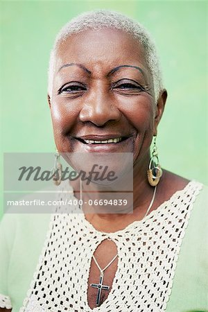 Old black woman portrait, lady in elegant clothes smiling on green background Stock Photo - Budget Royalty-Free, Image code: 400-06694839
