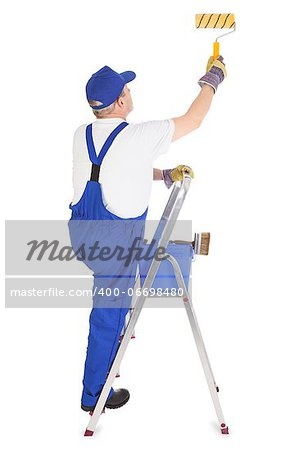 house painter on the ladder is painting invisible wall Stock Photo - Budget Royalty-Free, Image code: 400-06698480