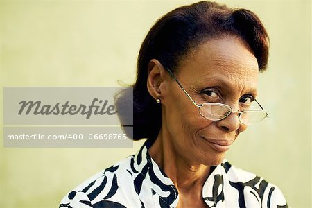 Senior people and confidence, portrait of proud african american woman with glasses smiling and looking at camera. Copy space Stock Photo - Budget Royalty-Free, Image code: 400-06698765