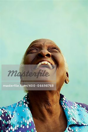 Old people and emotions, portrait of bizarre senior african american lady laughing with head tilted up. Copy space Stock Photo - Budget Royalty-Free, Image code: 400-06698768