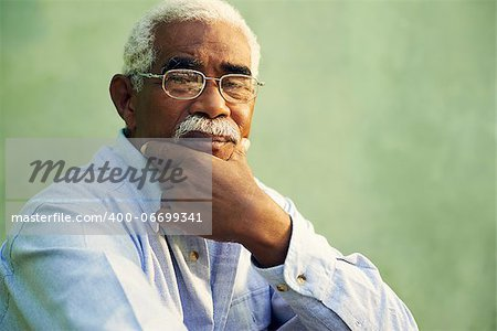 Black people and emotions, portrait of depressed senior man with glasses looking at camera. Copy space Stock Photo - Budget Royalty-Free, Image code: 400-06699341