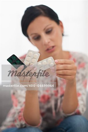 Closeup on pills in hand of concerned young woman Stock Photo - Budget Royalty-Free, Image code: 400-06699964