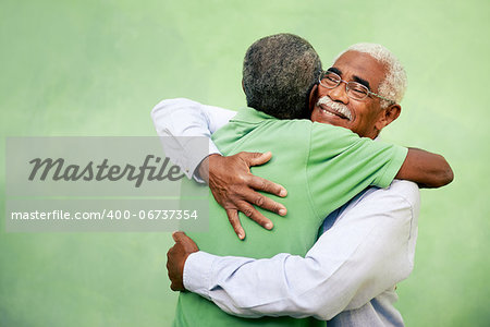 Active retired old men and leisure, two senior black brothers hugging outdoors Stock Photo - Budget Royalty-Free, Image code: 400-06737354