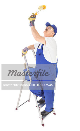house painter on the ladder is painting invisible ceiling Stock Photo - Budget Royalty-Free, Image code: 400-06737545