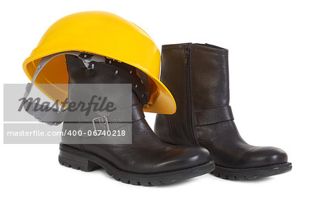 Boots and yellow hard hat over white background, small natural shadow under boots Stock Photo - Budget Royalty-Free, Image code: 400-06740218