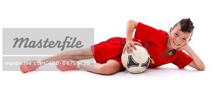 Young boy lying with soccer ball, studio shot Stock Photo - Budget Royalty-Free, Image code: 400-06759420
