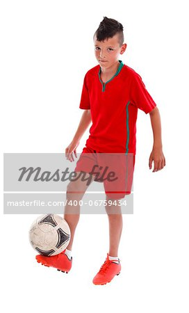 Young kid in red uniform  playing football - studio shot Stock Photo - Budget Royalty-Free, Image code: 400-06759434