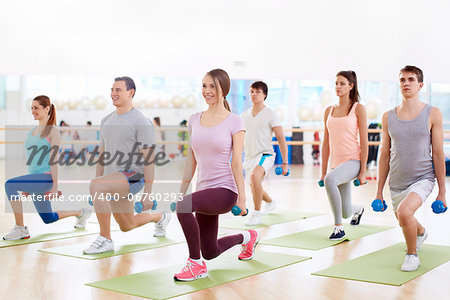 Young people with a dumbbell in fitness club Stock Photo - Budget Royalty-Free, Image code: 400-06760293