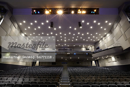 Interior of empty cinema auditorium with lines of chairs. Stock Photo - Budget Royalty-Free, Image code: 400-06771118