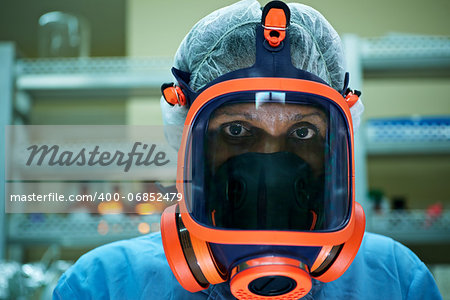 Medicine and science, and pharmaceutical laboratory with scientist wearing mask and looking at camera Stock Photo - Budget Royalty-Free, Image code: 400-06852479
